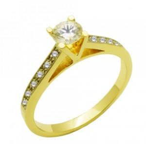 Χρυσό μονόπετρο δαχτυλίδι...